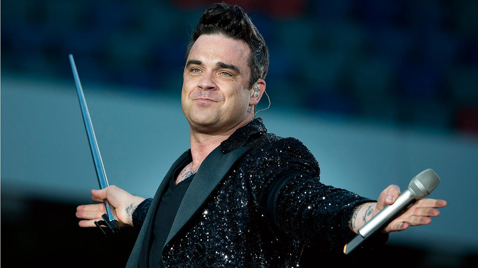 Robbie Williams hade blod i hjärnan och tvingades ställa in konserter.