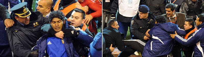 Medlemmar ur Venezuelas delegation tas om hand av polis efter semifinalen mot Paraguay i Copa America.