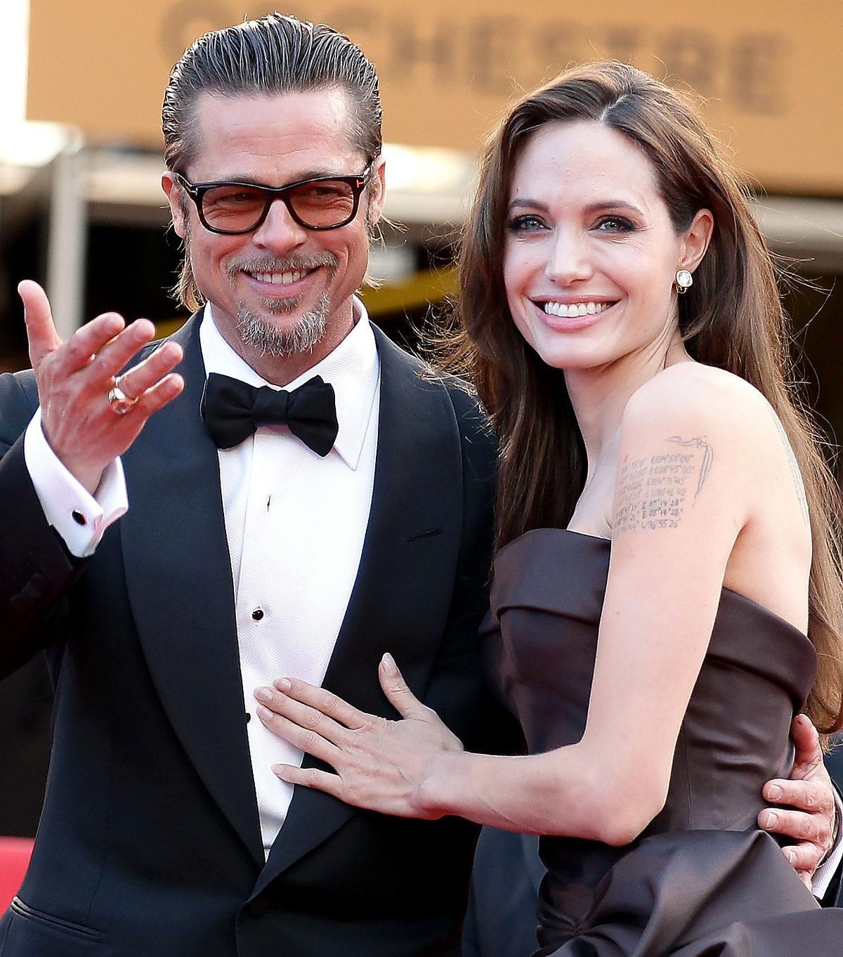 """SUGEN PÅ NYA UTMANINGAR  Brad Pitt och hustrun Angelina Jolie på väg in till visningen av """"The tree of life"""" i Cannes."""