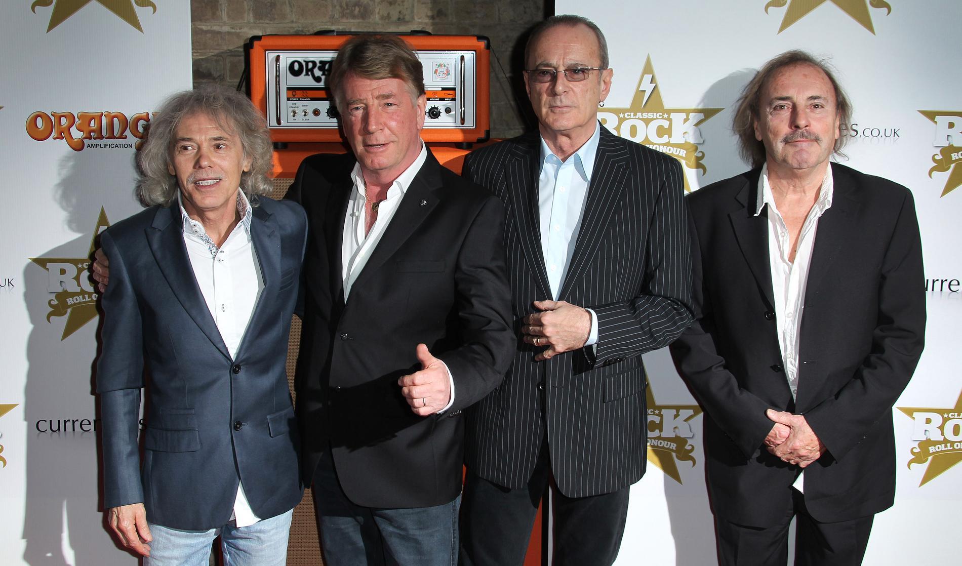 Alan Lancaster (längst till vänster) med sina kollegor i Status Quo 2012. Arkivbild.