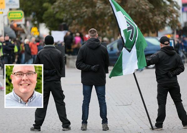 """Magnus Kolsjö, RFSL: """"I år kommer nazisterna till Almedalen men rikspolischefen Dan Eliasson har inte gett polisen på Gotland tillräckligt med resurser för att hantera de hot mot hbtq-personer som är ett resultat av nazisternas närvaro. """" (Stora bilden är från en tidigare demonstration i Visby, av nazistiska Nordiska Motståndsrörelsen)."""
