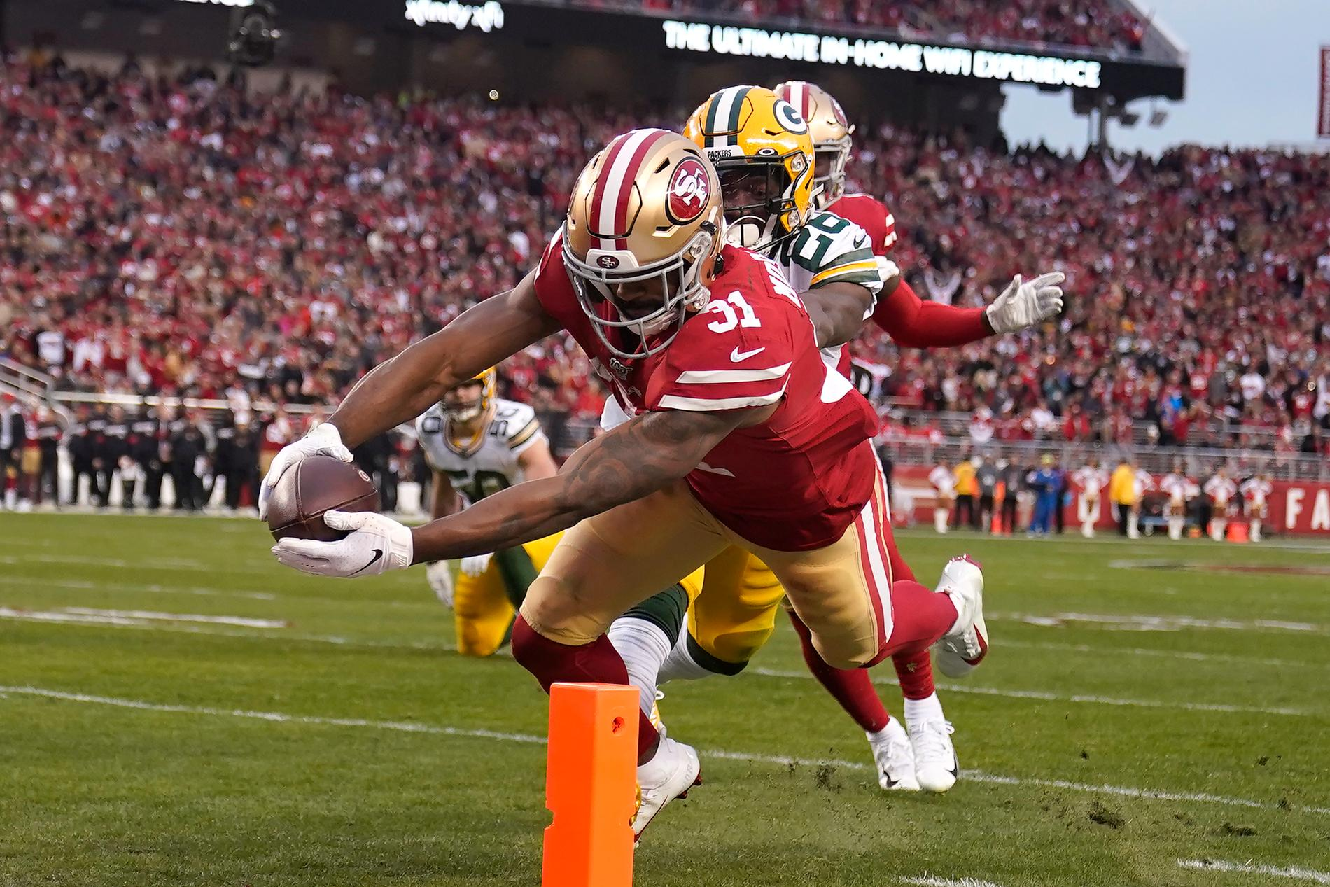 Raheem Mostert gör en av sina fyra (!) touchdowns i segern mot Green Bay Packers.
