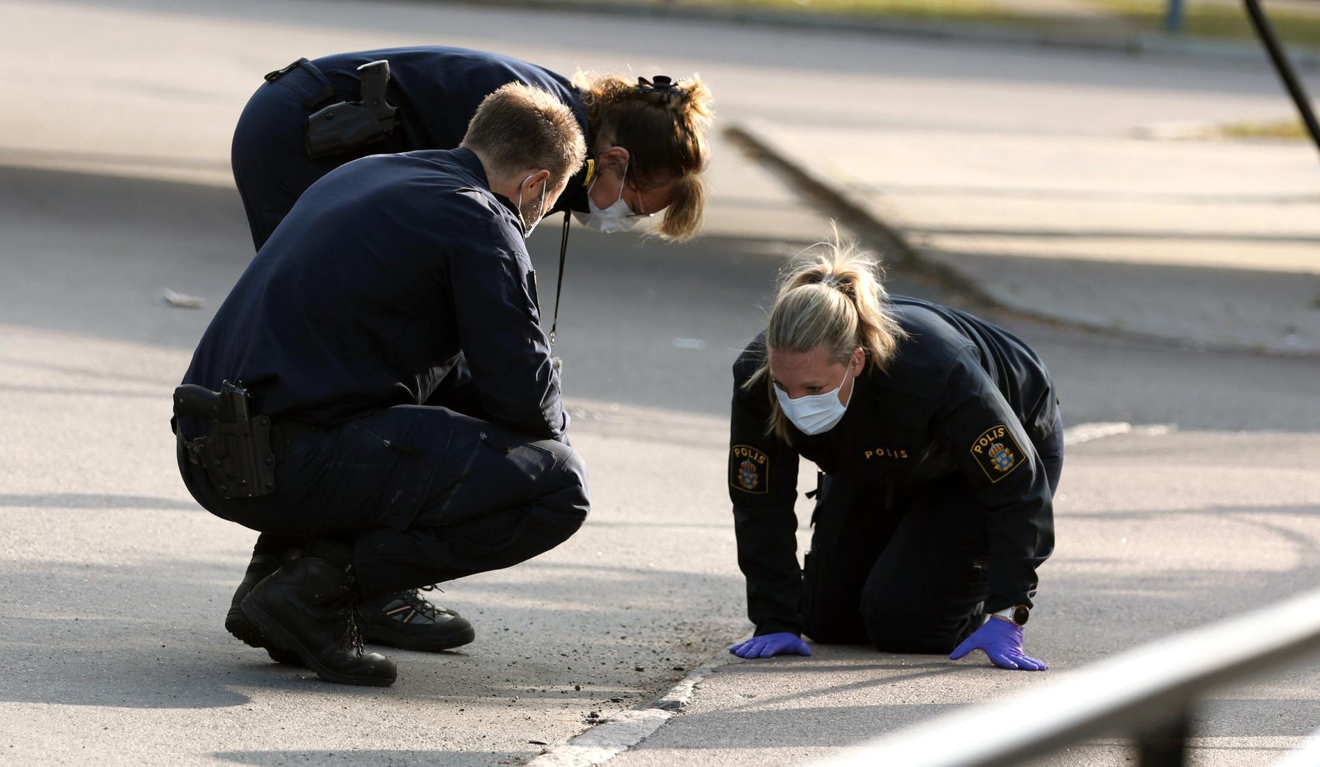 Teknisk undersökning efter dödsskjutningen.