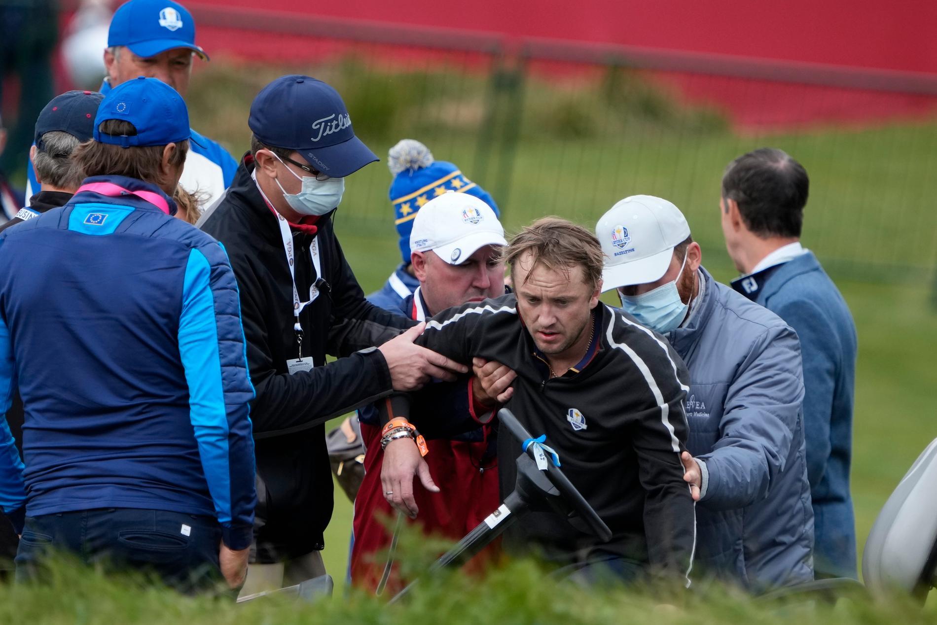 Tom Felton får hjälp efter att ha kollapsat på golfbanan.
