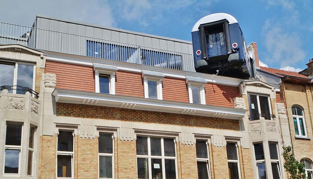 Train Hostel i Belgien har ett gammalt tåg inbyggt i huset.