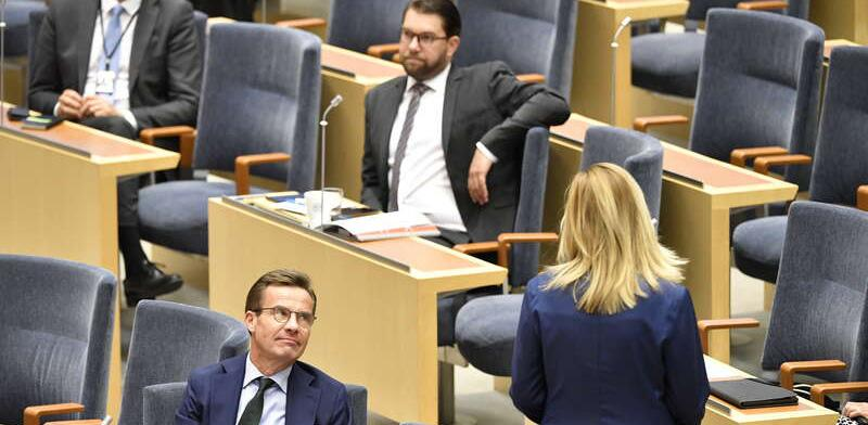 Ulf Kristersson, Jimmie Åkesson och Ebba Busch under onsdagens partiledardebatt.