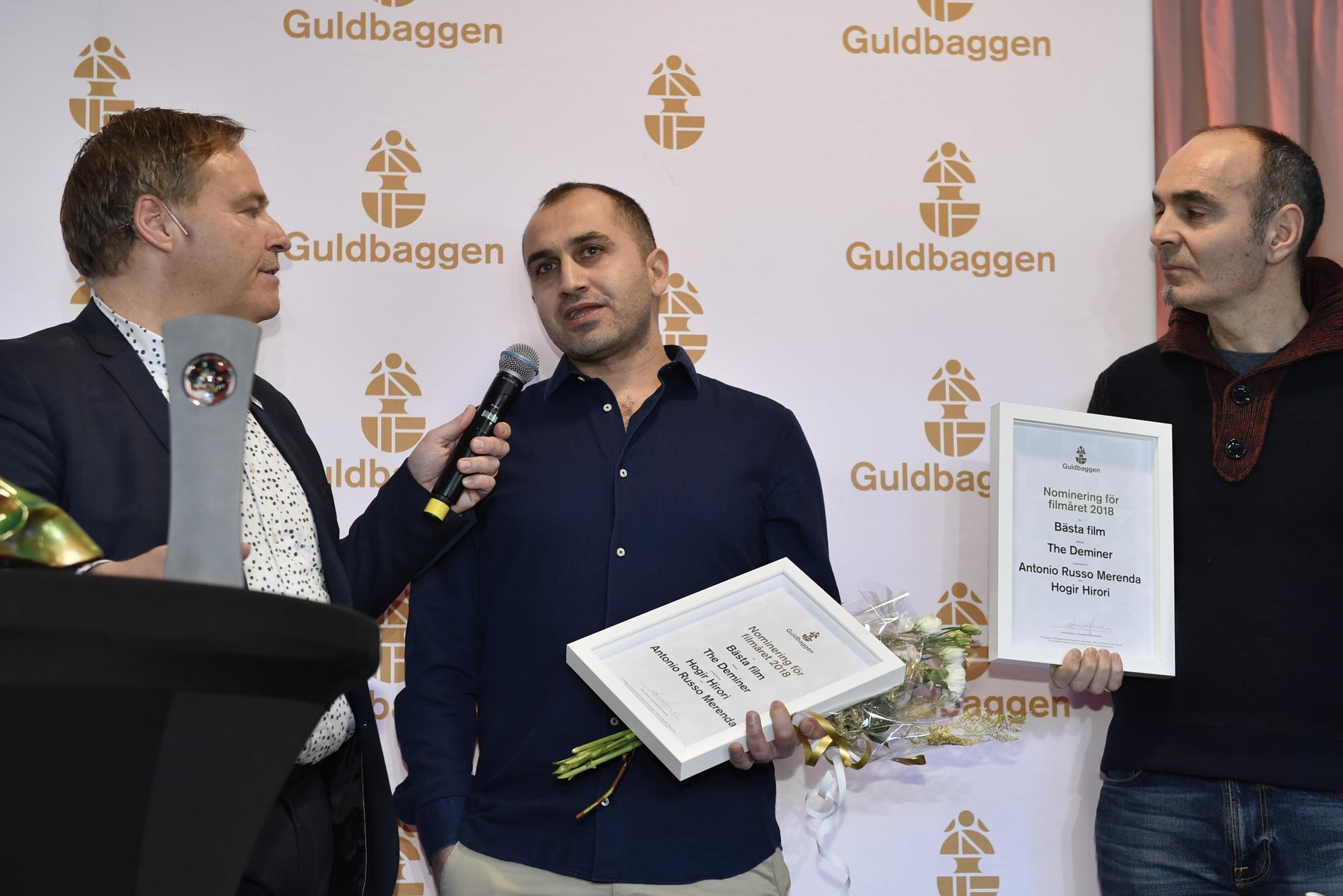 """Hogir Hirori (mitten) i samband med Guldbaggenomineringarna 2019. Till höger syns producenten Antonio Russo Merenda, som också har producerat vinnarfilmen """"Sabaya"""". Arkivbild."""